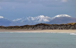 West beach Berneray with the snow covered hills of Harris behind.