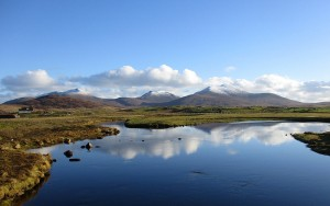 The hills of South Uist from the Howmore Bridge. With thanks to Rupert Fleetingly and the Geograph licence.